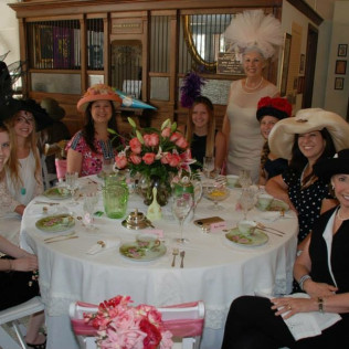 A group of women enjoying a social event with Greg County Historical museum